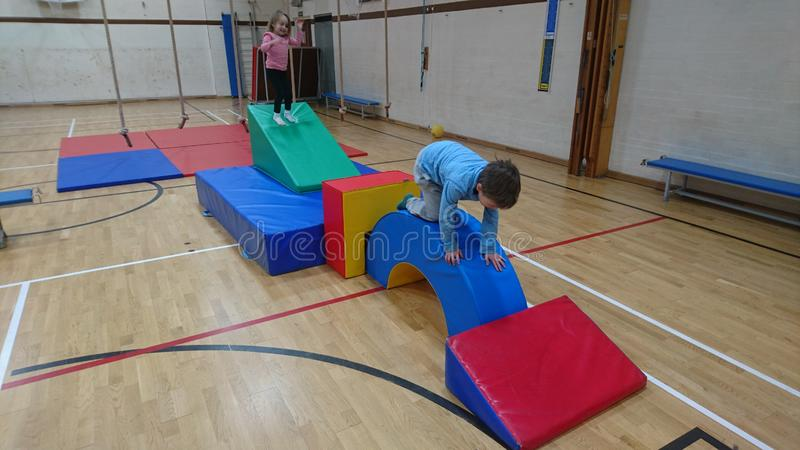 Girl and boy walking over an obstacle course royalty free stock photography