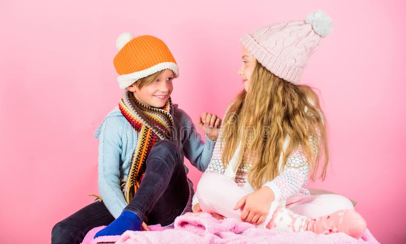 Girl and boy wear knitted winter hats. Winter season fashion accessories and clothes. Kids knitted winter hats. Children stock image