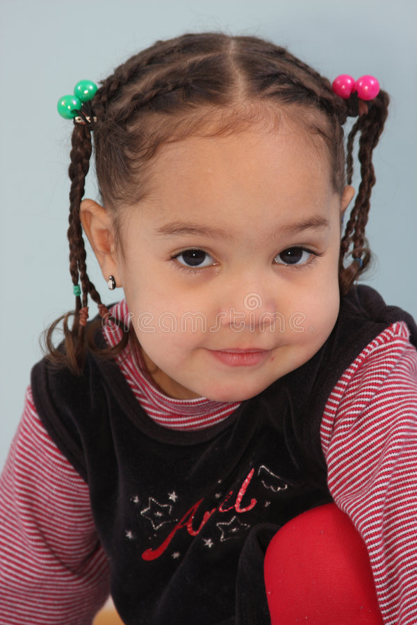 Girl with braids. A little melano girl with braids posed royalty free stock photos