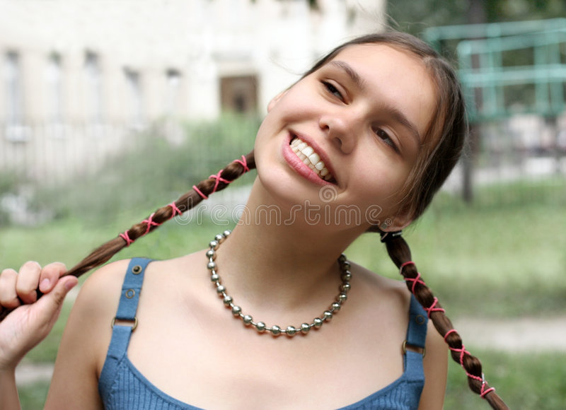 Girl with braids smiling stock photos