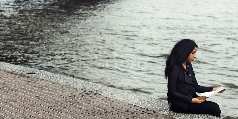 Girl Breakup Relationship Sitting Alone Concept stock photography