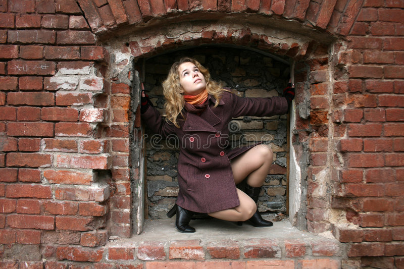 Download A girl in a brick recess stock photo. Image of brickwork - 7073612