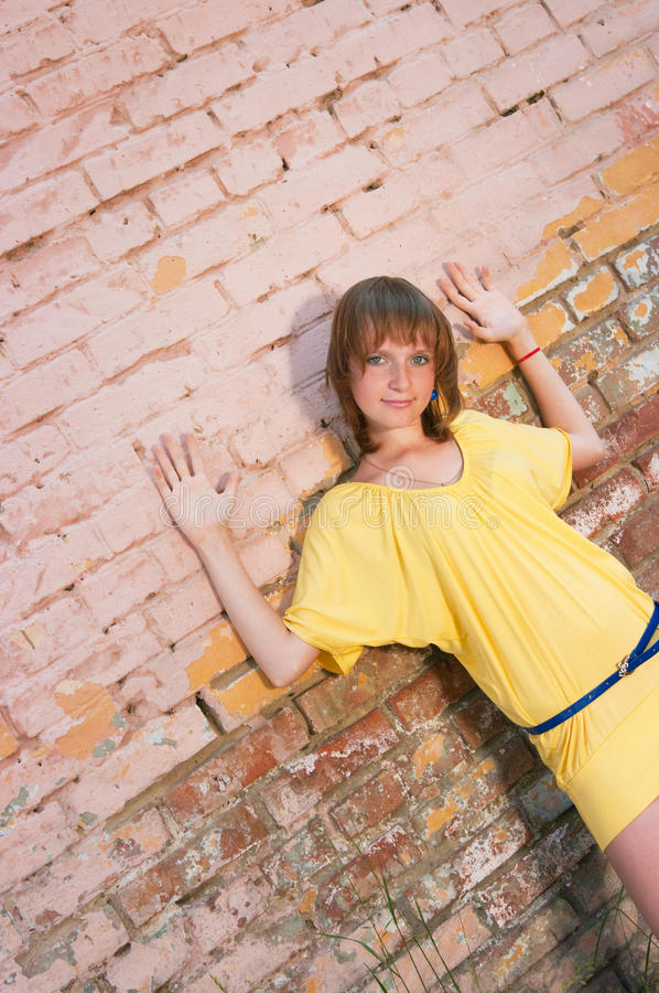 The girl at a brick wall stock photography