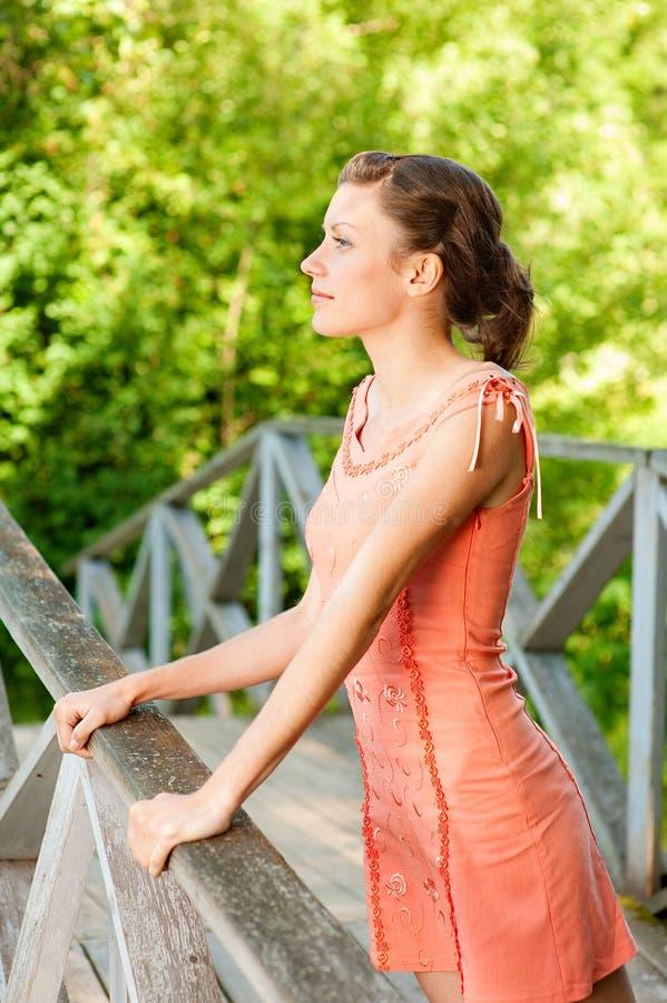 Girl on bridge royalty free stock photos