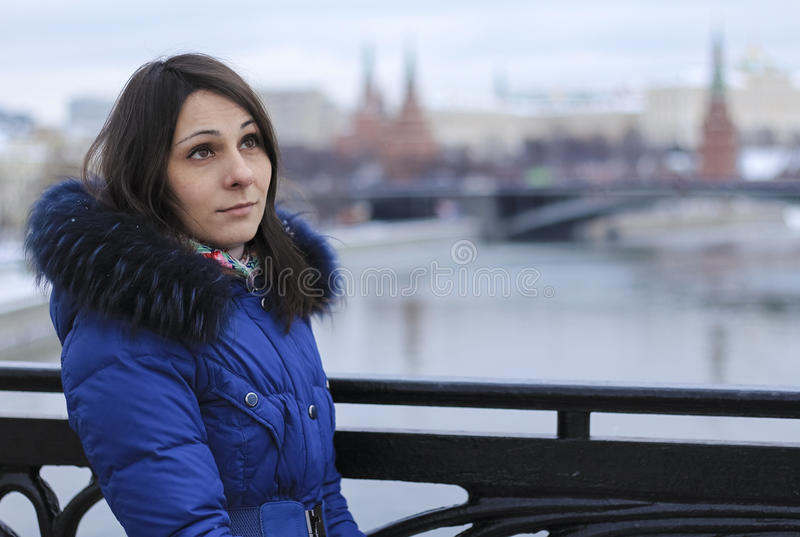 Girl on the bridge on the background of Moscow Kremlin stock image