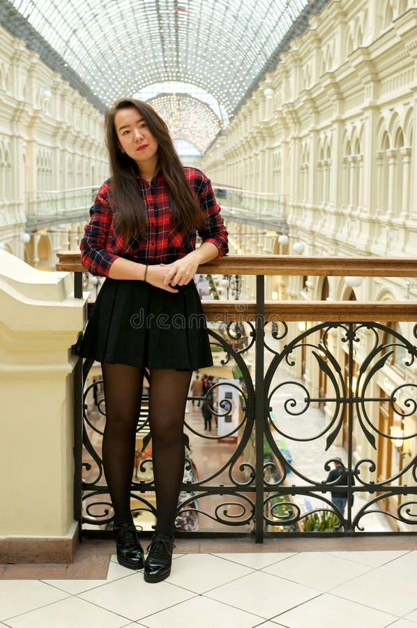 Girl on a bridge with railings stock photo