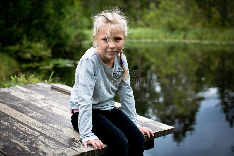 Girl on a bridge royalty free stock photo