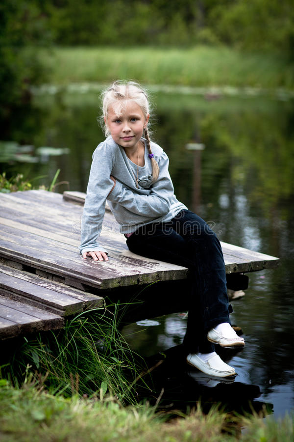 Girl on a bridge royalty free stock photography