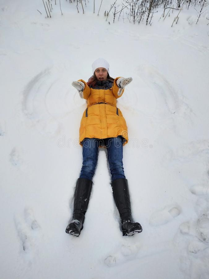 A girl walks into a snow-covered Park royalty free stock photography