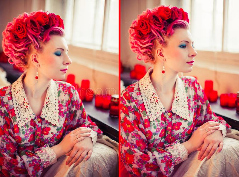 girl in bright red ethnic dress with gentle make-up and pink dreadlocks stock image
