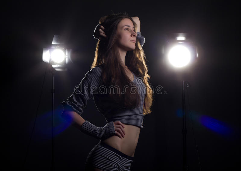Download Girl With Bright Studio Flashes Stock Photography - Image: 19922792
