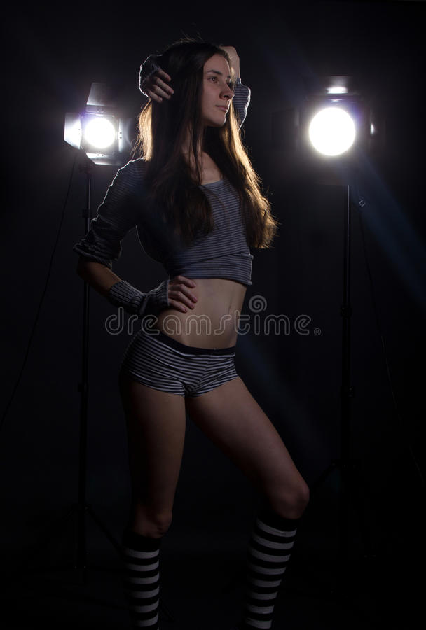 Girl with bright studio flashes and flare