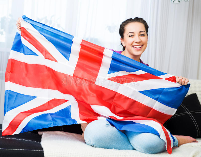 Girl with british flag. British girl holding the Jack Union flag royalty free stock image