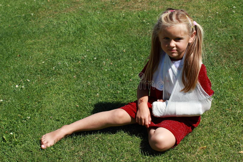Girl with broken hand royalty free stock photography