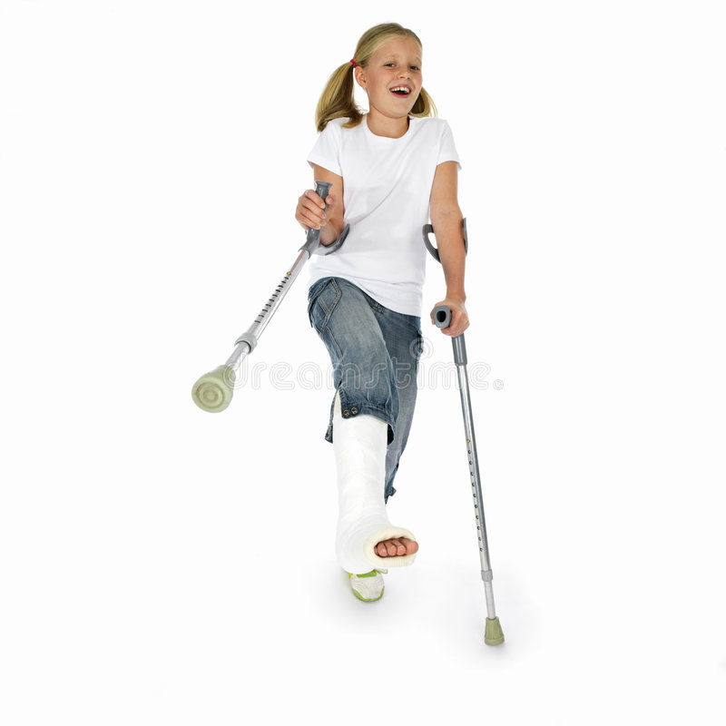 Girl With A Broken Leg Dancing On Crutches Stock Image