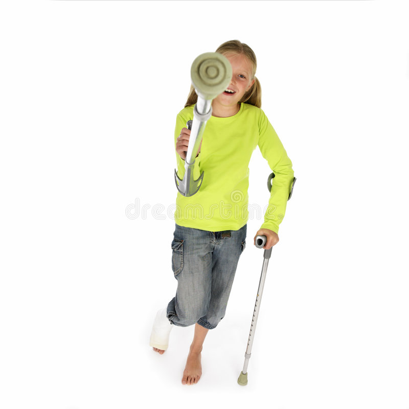 Girl with a broken leg walking on crutches royalty free stock photo