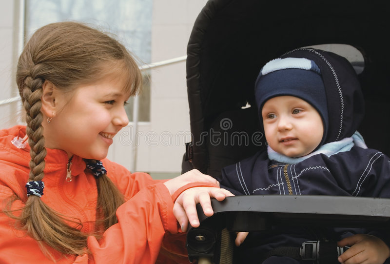 Girl with brother in a carriage (1) stock photography
