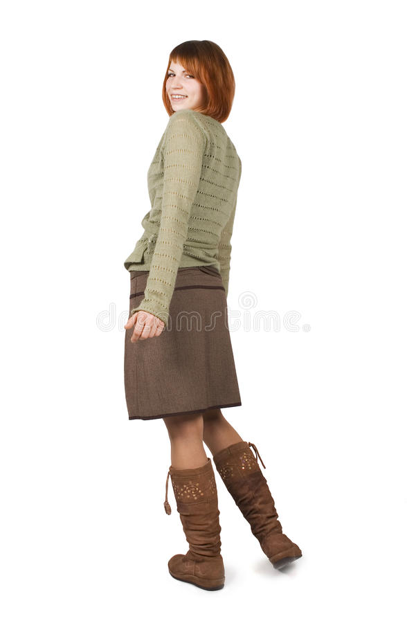 Girl in brown skirt standing and looking back royalty free stock image