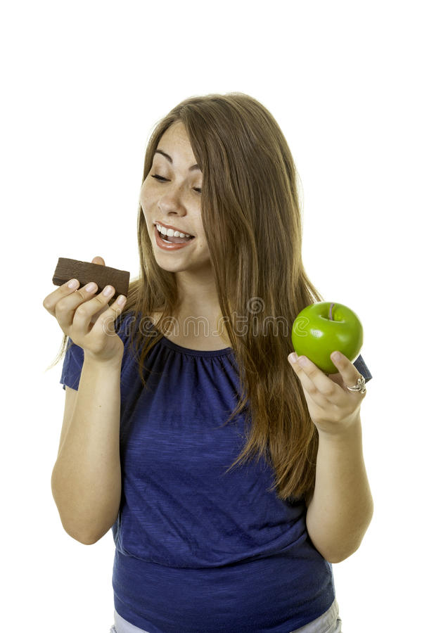 Girl with brownie and apple royalty free stock photography