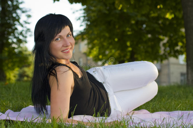 Girl-brunette On A Grass Royalty Free Stock Photography