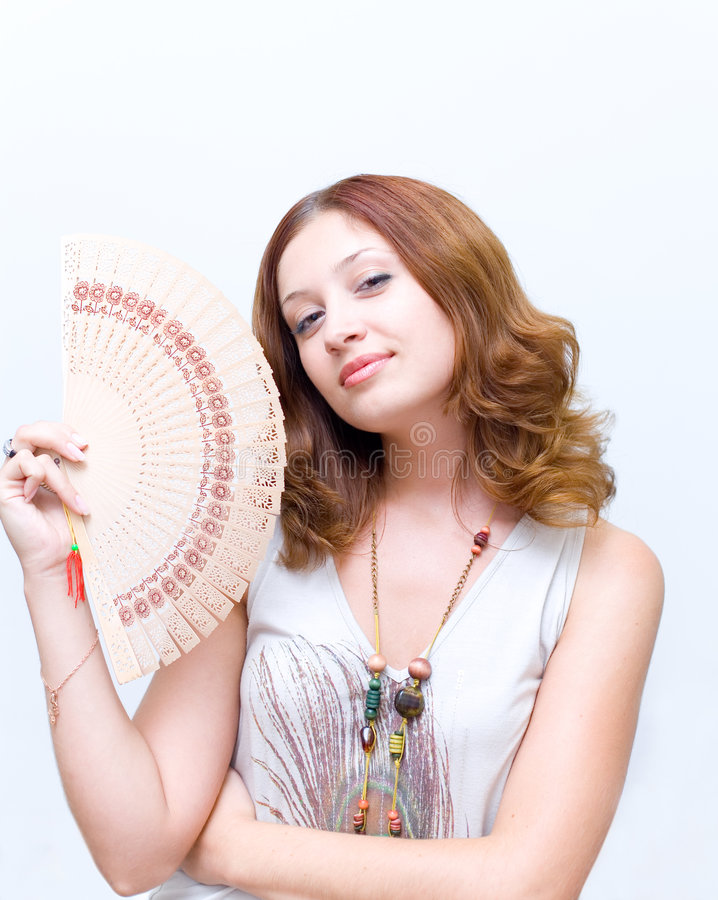 Free Girl Brush Away Face By Fan Royalty Free Stock Photography - 4390207