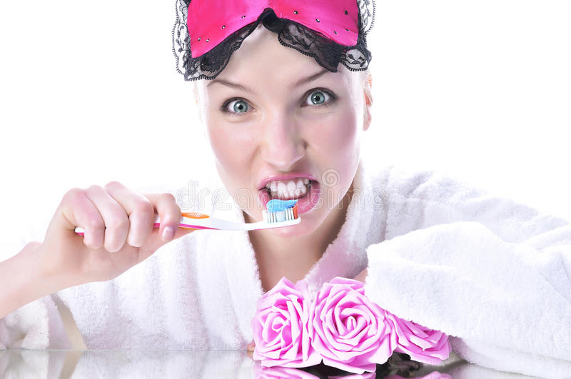 Girl Brushes Her Teeth Royalty Free Stock Image