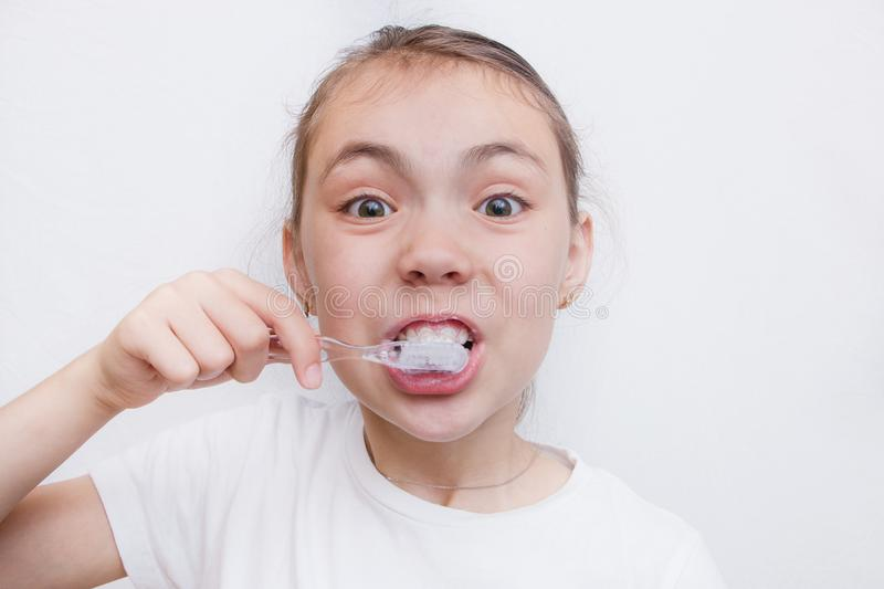 Girl brushing cleaning teeth. Girl with toothbrush. Oral hygiene, isolated royalty free stock photo