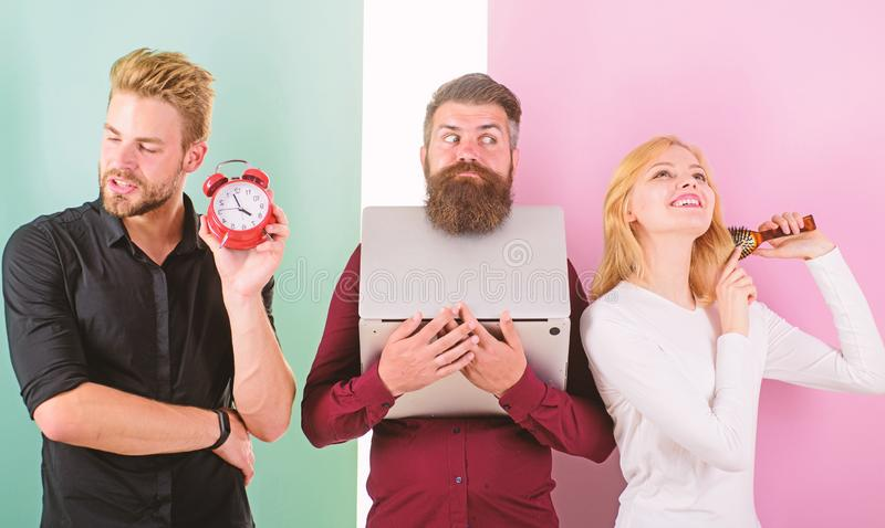 Girl brushing hair men work laptop. Punctuality and timing. Annoyed boss. Unpunctual people usually annoying coworkers royalty free stock photography