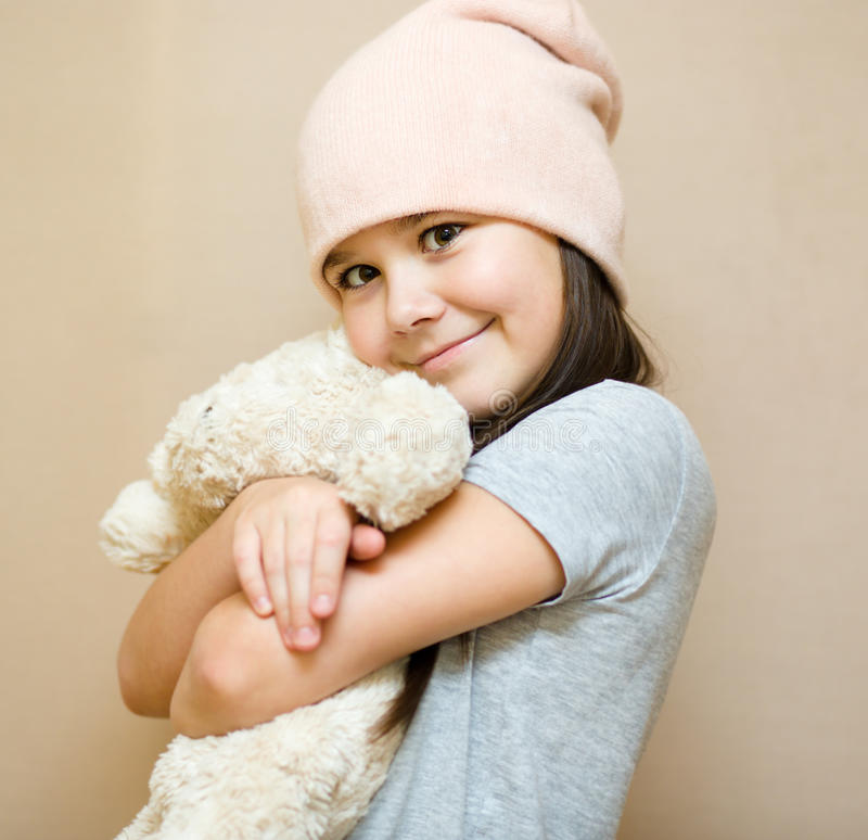 Girl is brushing her teddy bear royalty free stock photo
