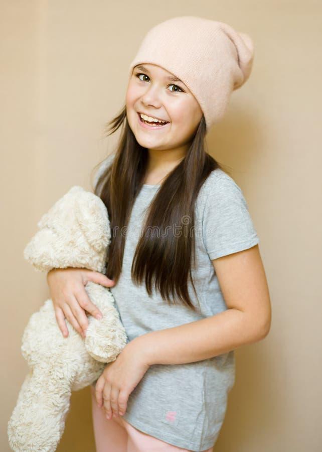 Girl is brushing her teddy bear royalty free stock image