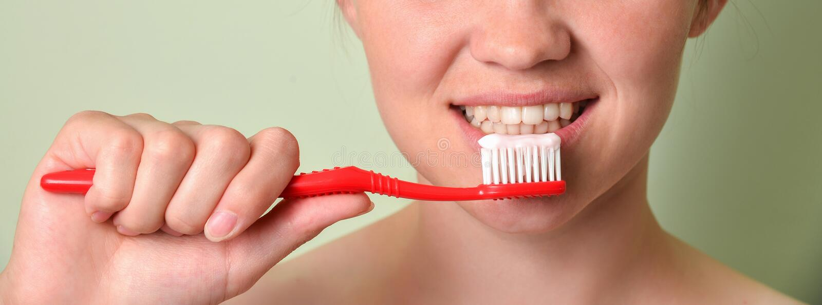 Girl brushing her teeth closeup, dental care concept royalty free stock images