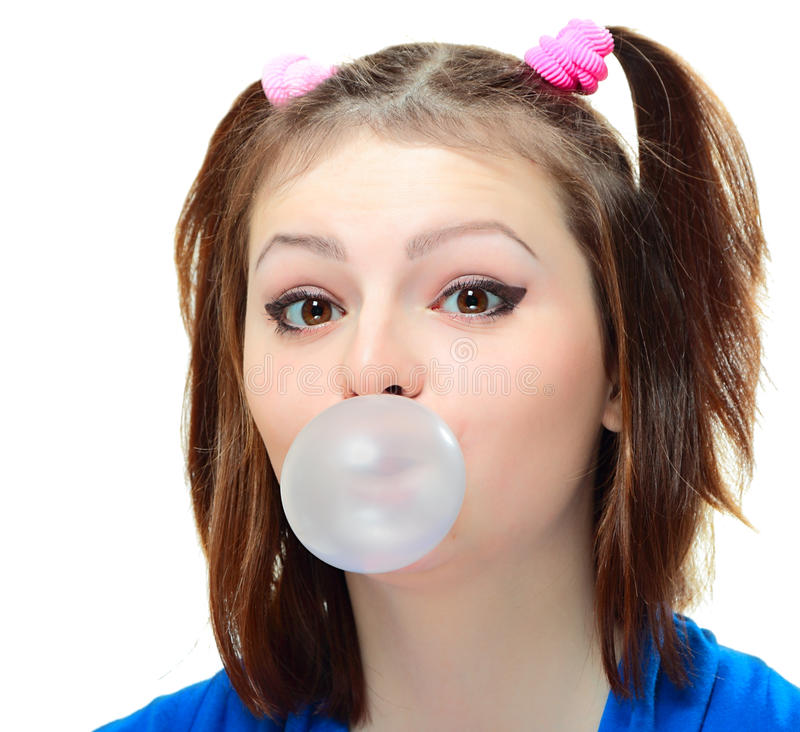 Girl with bubble. Beautiful young lady blowing big bubble gum on white background stock photos