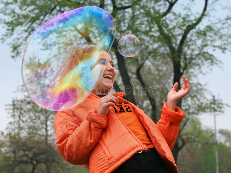 Girl with bubbles stock images
