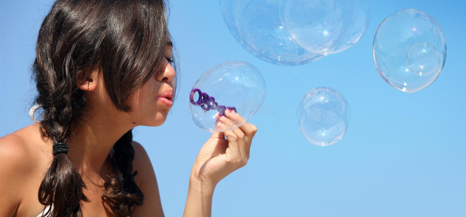 Girl with bubbles royalty free stock photography