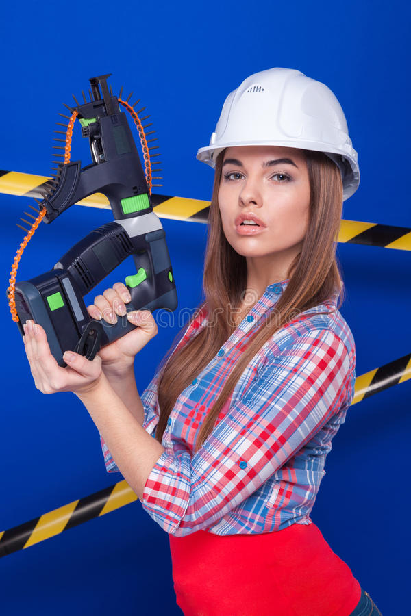Free Girl Builder In The Construction Helmet And Goggles With A Construction Tool On A Blue Background Royalty Free Stock Photography - 68633787