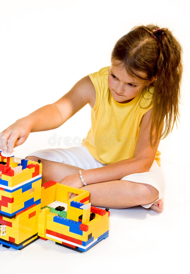 Girl is building house. Of dream royalty free stock image