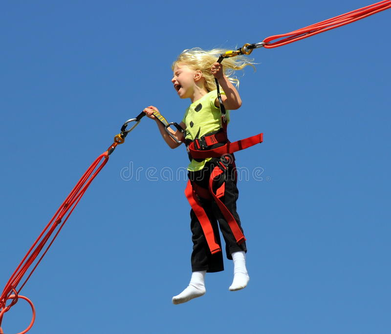 Download Girl on bungee trampoline stock image. Image of blue - 15630535
