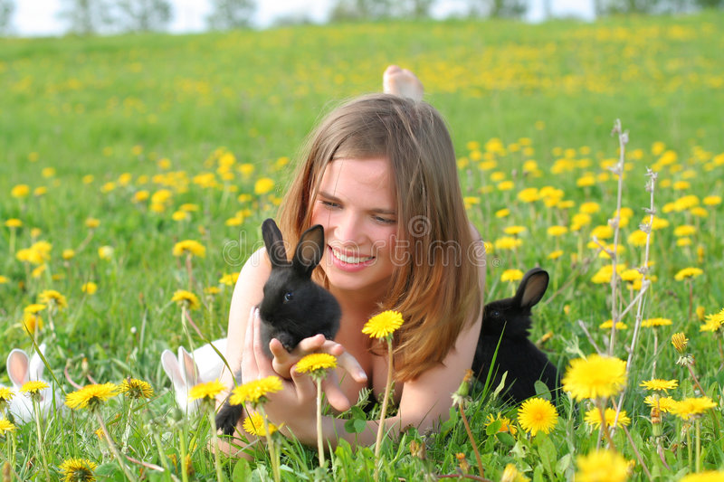 Download Girl with bunnies stock photo. Image of cute, leporidae - 3811626