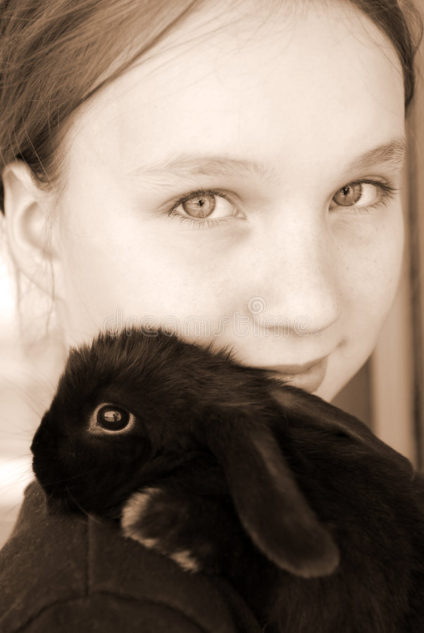 Girl and bunny stock images