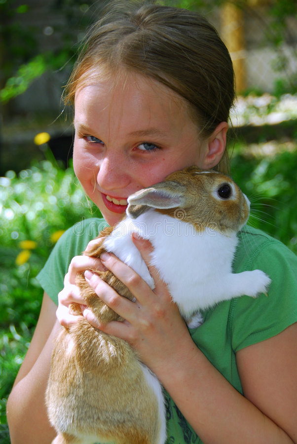 Girl and bunny royalty free stock image