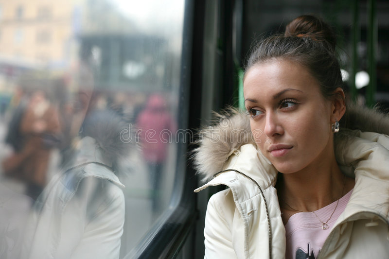 The girl in the bus royalty free stock photos