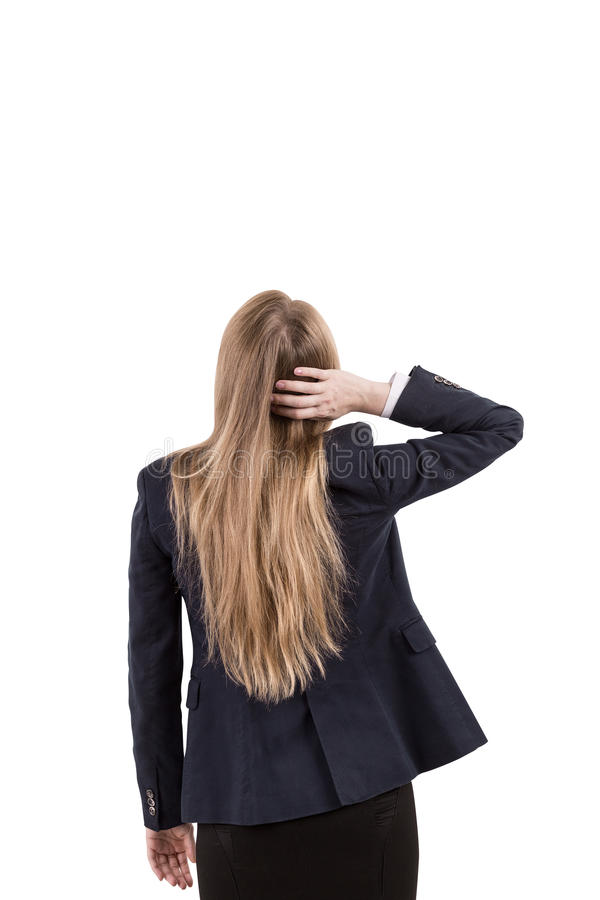 Girl in business suit scratching her head royalty free stock photo