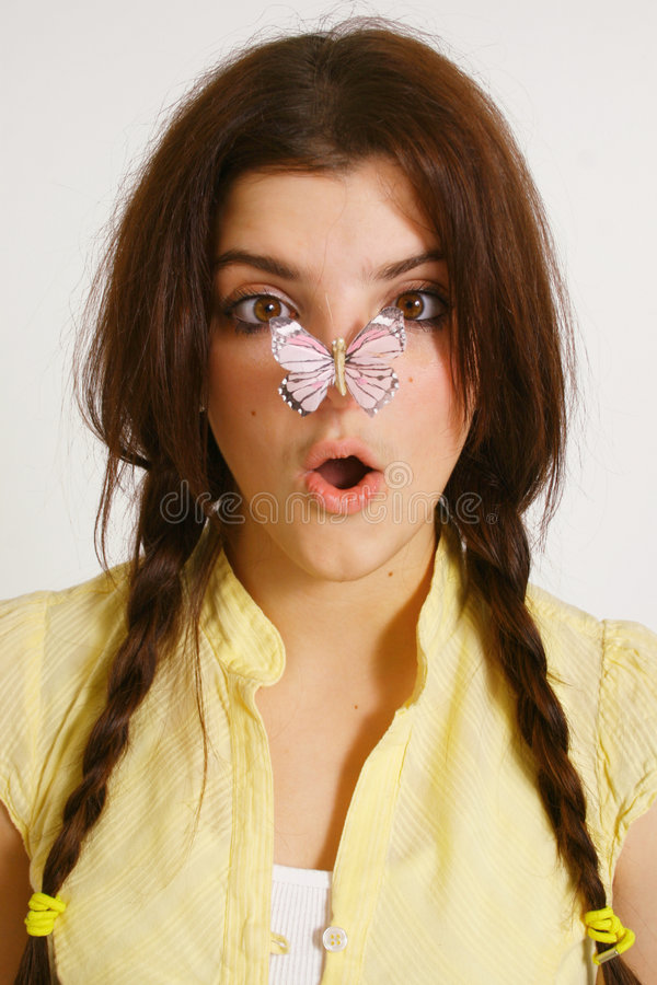 Girl with butterfly on nose stock photography