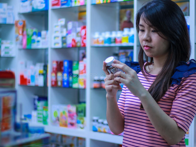 Girl buy drug stock photography