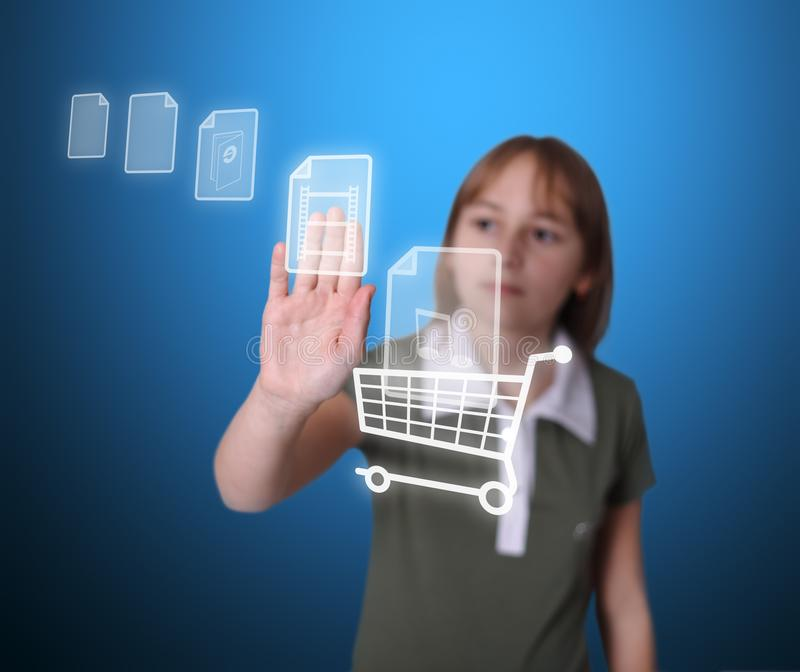 Girl buying multimedia items online royalty free stock images