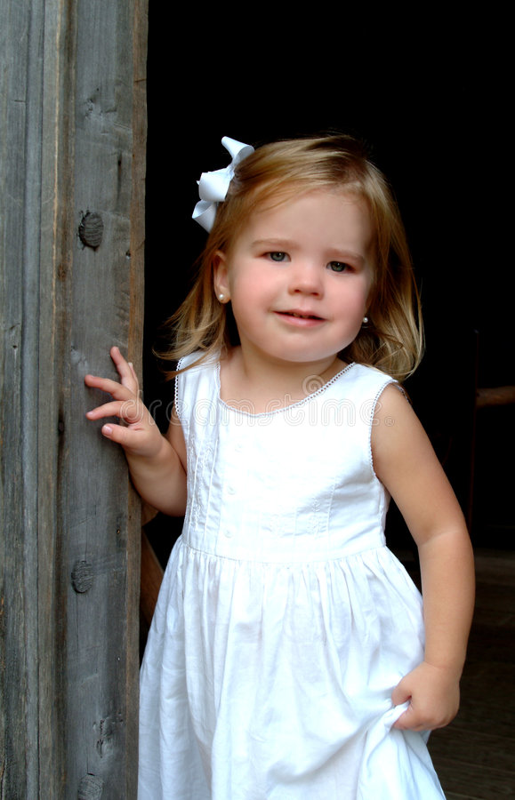 Girl in Cabin Doorway royalty free stock photography