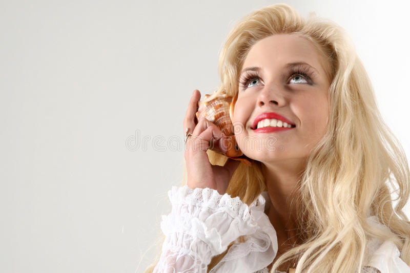 Download Girl call by shell phone stock photo. Image of female - 12167744
