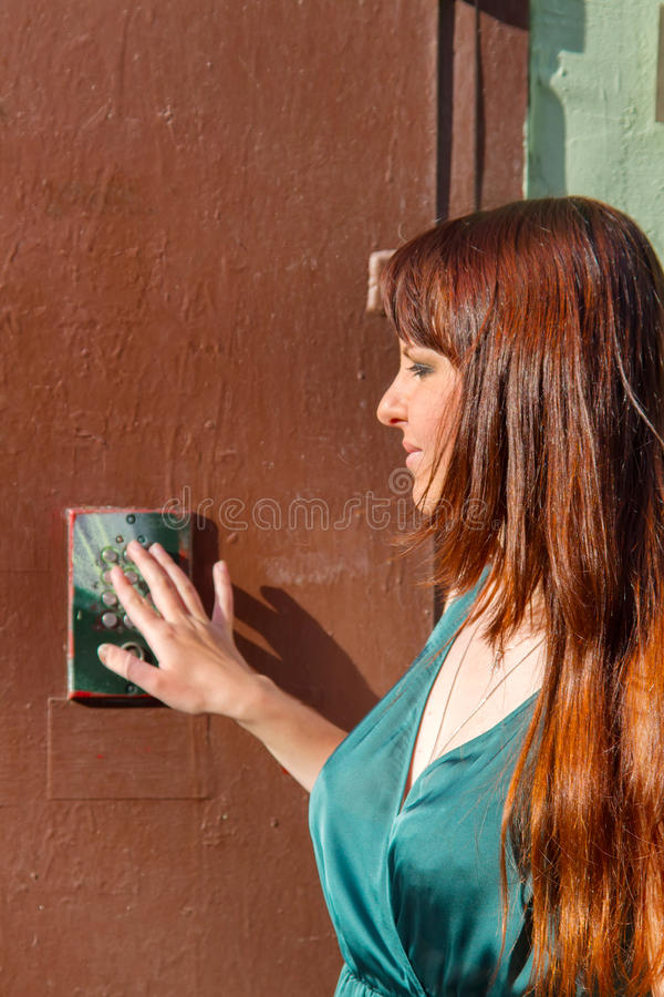 Girl came to visit and forgot code digital door locks. What to click? Girl came to visit and forgot code digital door locks combination lock, security lock royalty free stock images