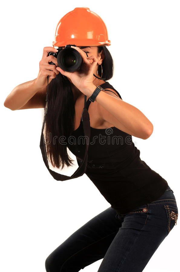 A girl with a camera in his helmet royalty free stock image