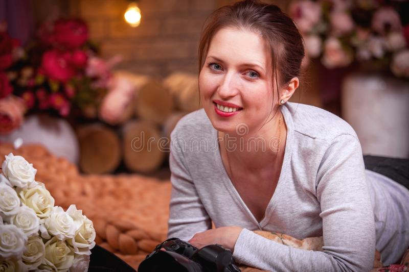 The girl with the camera and smiling royalty free stock photography